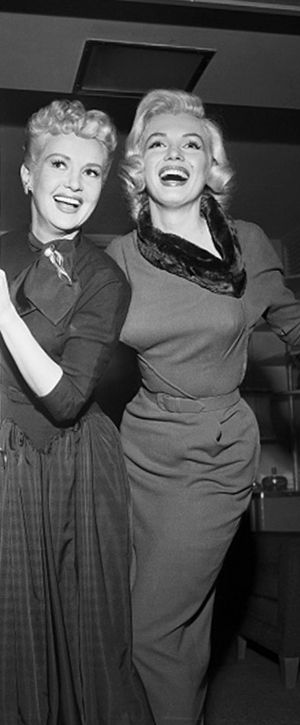 Marilyn Monroe and Betty Grable on the set of How To Marry a Millionaire, 1953.