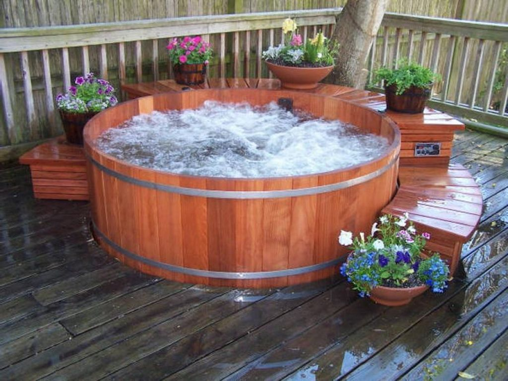 Hot Tub In Backyard Ideas wonderful nature stone hexagon outdoor hot tub in Stunning Round Hot Tub Idea Surrounded By Flowers On Backyard Deck