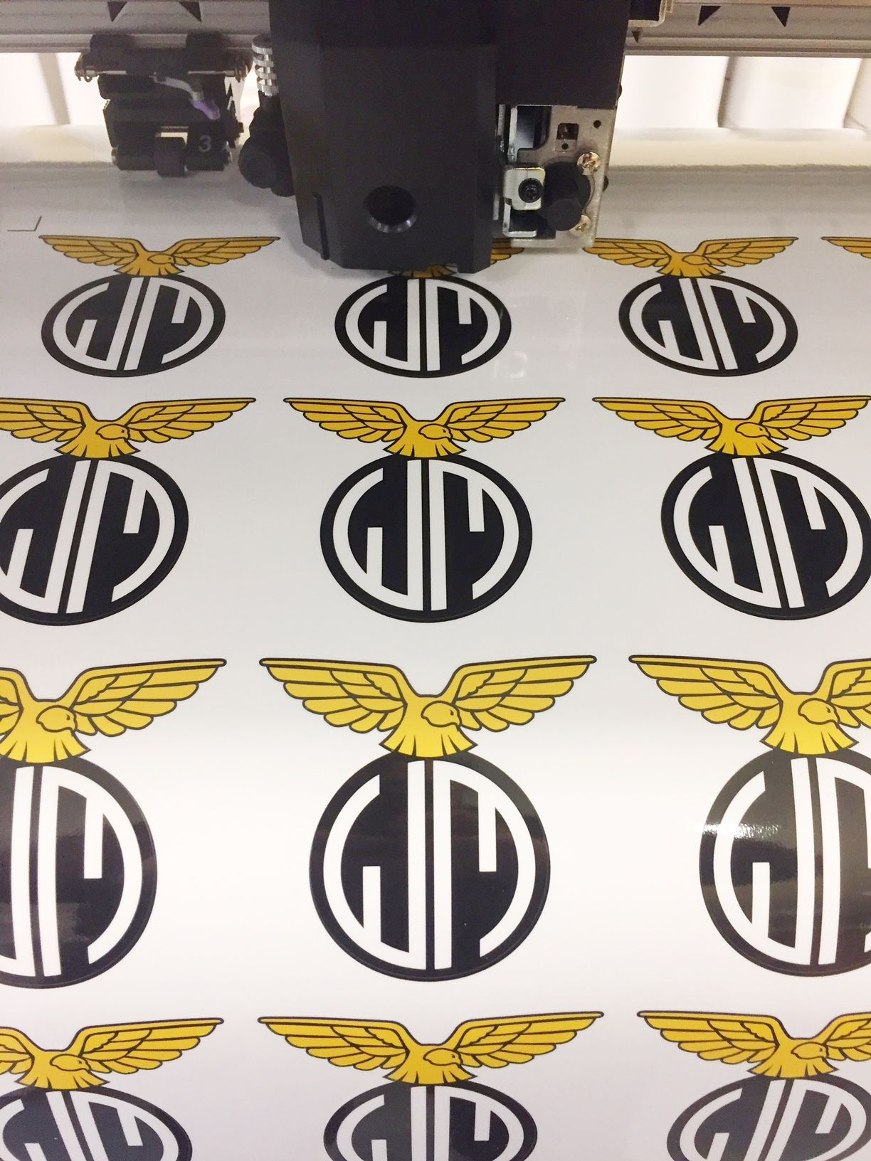 Custom bike stickers being printed before riding their way over to reckless motorcycles