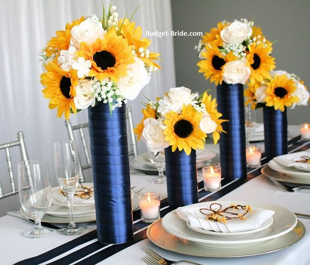 Tall Centerpieces with sunflowers and navy blue Tall Centerpieces with sunflowers and navy blue