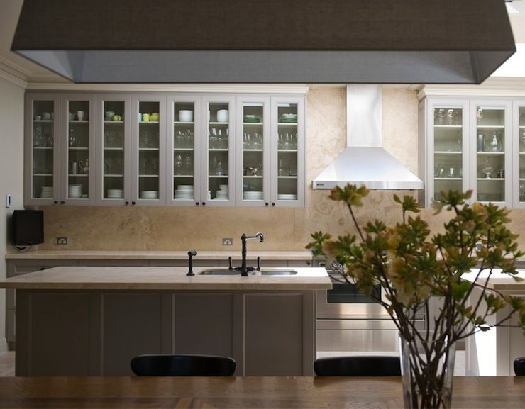 Stunning open plan kitchen with gray glass front upper cabinets and
