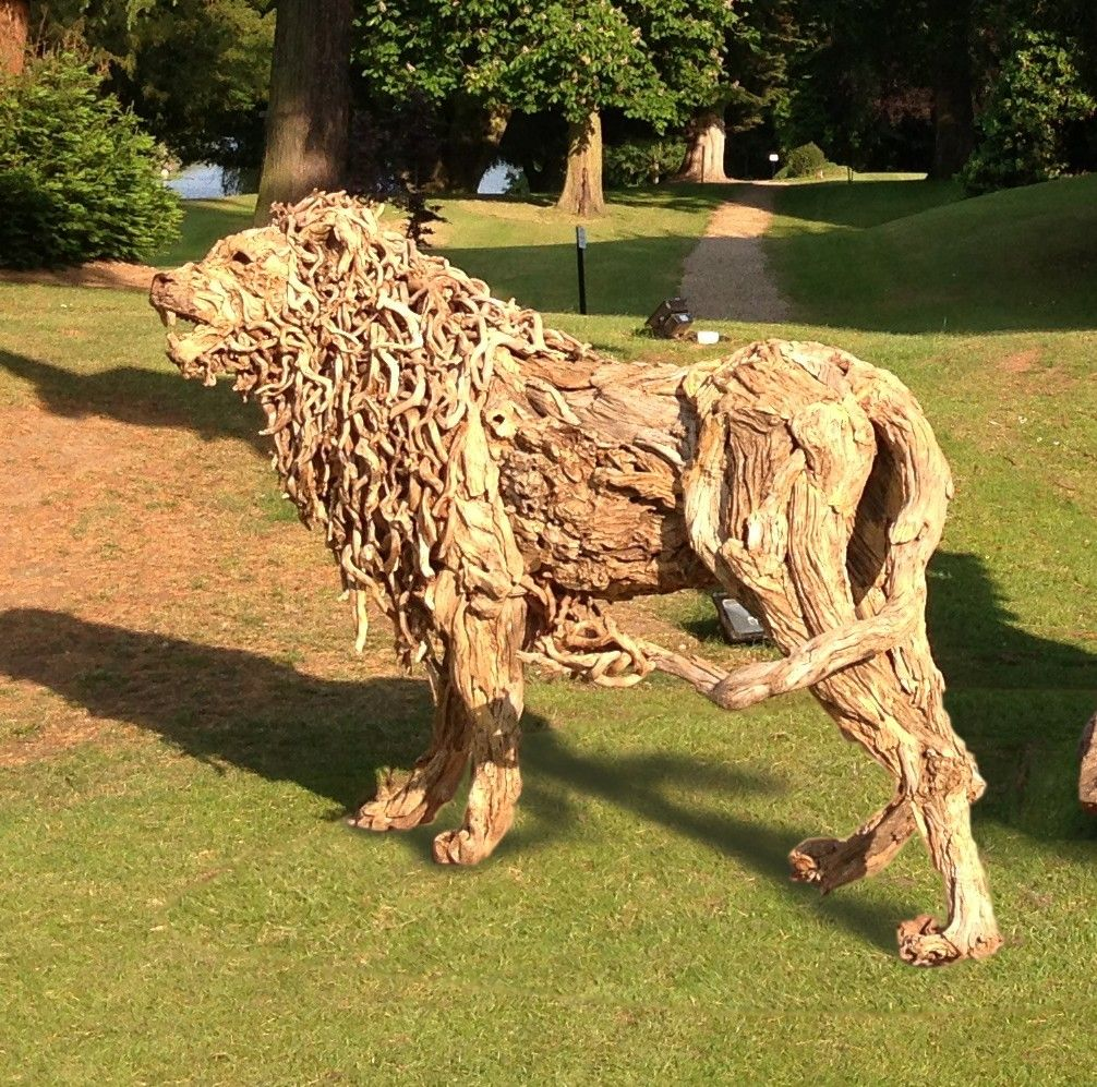 King of the pride a lifesized driftwood sculpture by Driftwood sculptures for garden