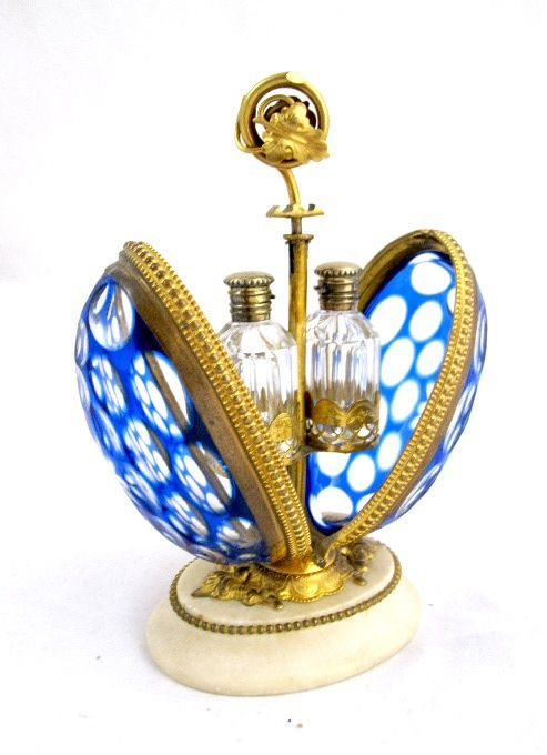 French 19th Century Glass Perfume Casket ~ French 19th Century blue and clear glass egg shaped casket with dore bronze mounts.  This stunning casket encloses two glass scent bottles with gilded silver vermeil stoppers.  SIZE: 6.5 Inches High: Scents 2 Inches High  16cms High :Scents 5cms High