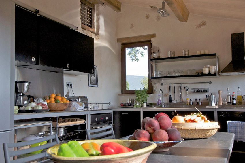 Functional kitchen all set up ready to cook in this self-catering holiday cottage in France. www.purefrance.com