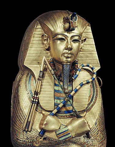 Mummiform coffin of gold with inlaid semi-precious stones and glass-paste, depicting the god Osiris, from the tomb of the pharaoh Tutankhamun, discovered in the Valley of the Kings, Thebes, Egypt, North Africa, Africa