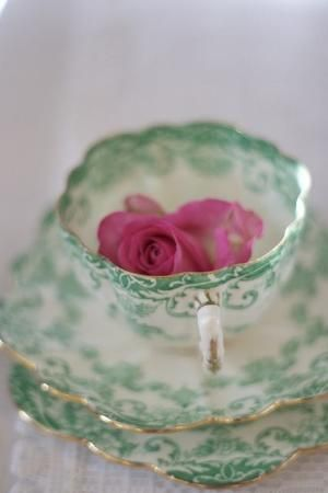 Very pretty green tea cup and saucer set by fashion online