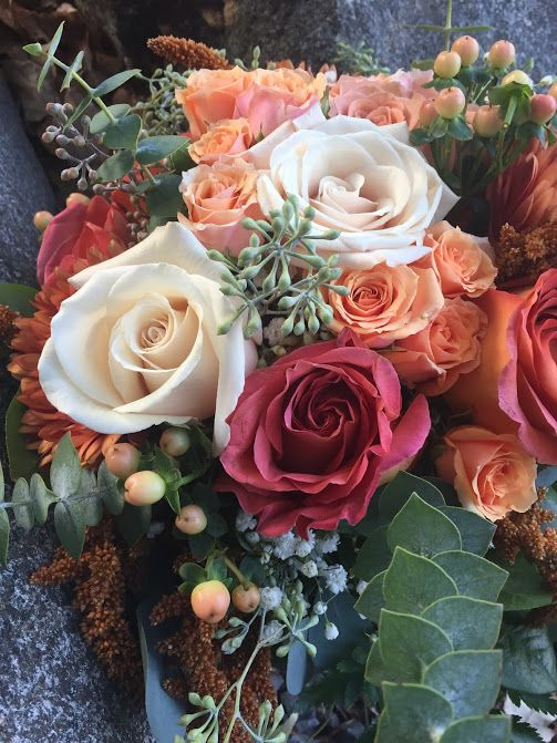 Gorgeous white, orange, and red roses with hypericum berry and ...