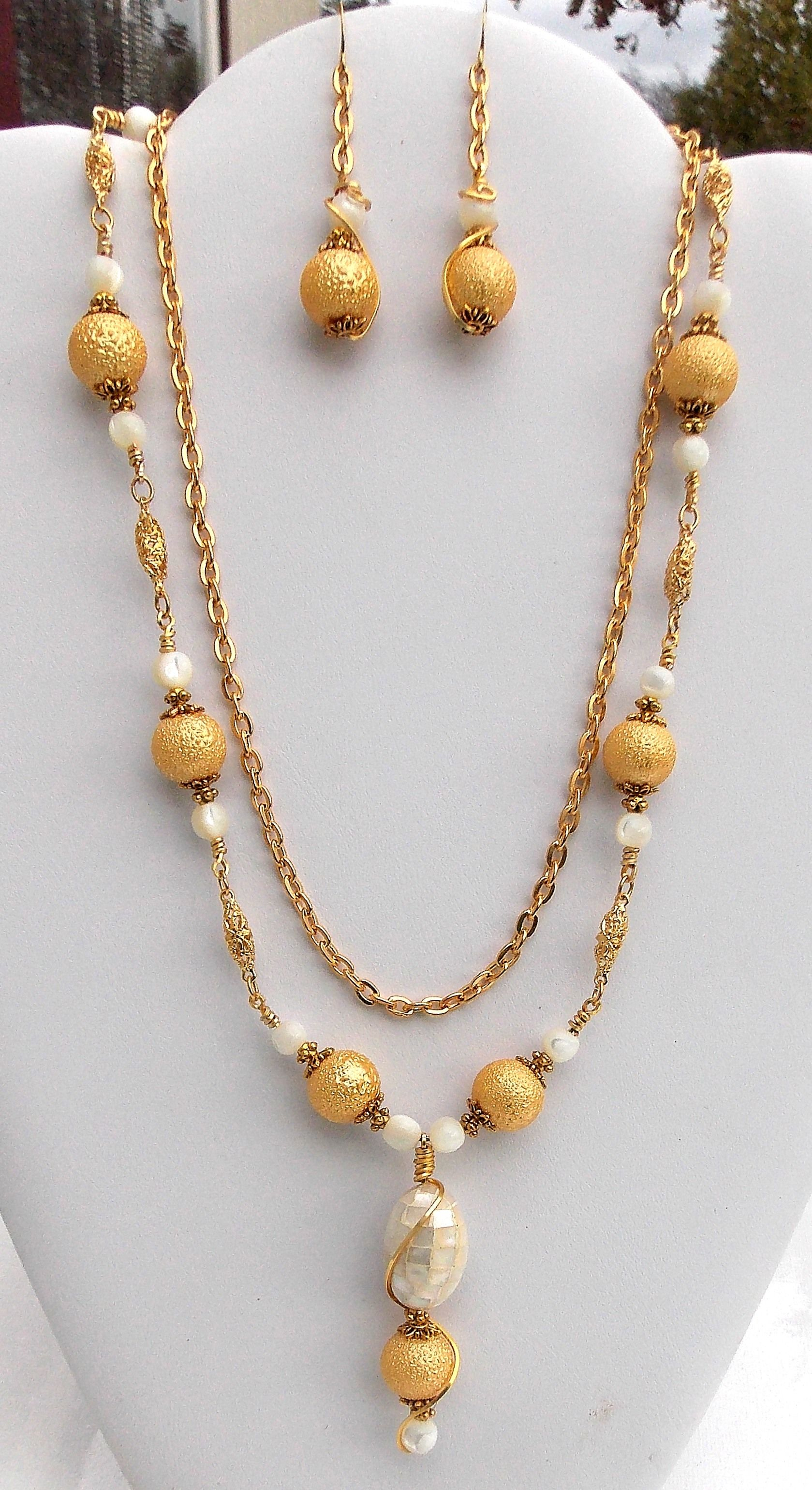 Gold textured glass and mother of pearl necklace and earring set