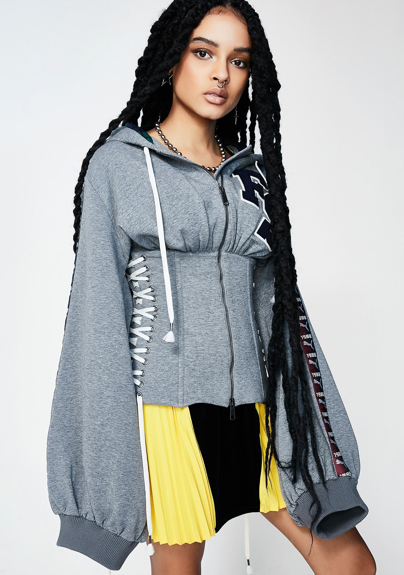36cbcba9c2c4 PUMA FENTY PUMA By Rihanna Fleece Side Lace Hoody got ya lookin  fine af.  This gray hoodie has a front zipper closure and corset-style lace-ups on  both ...