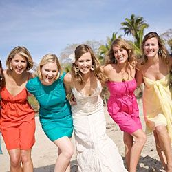 All bridesmaids wear different dresses in different colors. Yes please!