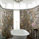 beautiful bathroom design with stone wall