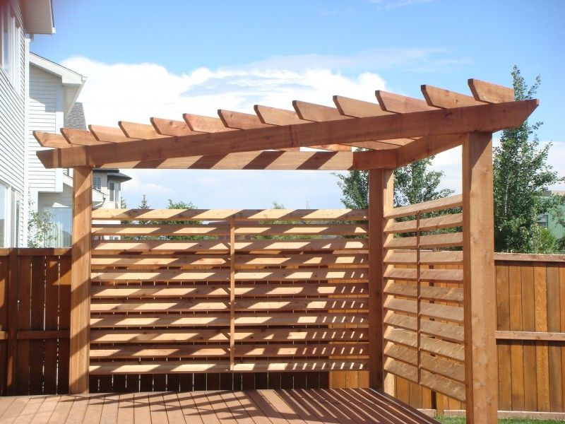 triangular cedar pergola with 1 6 slated privacy wall