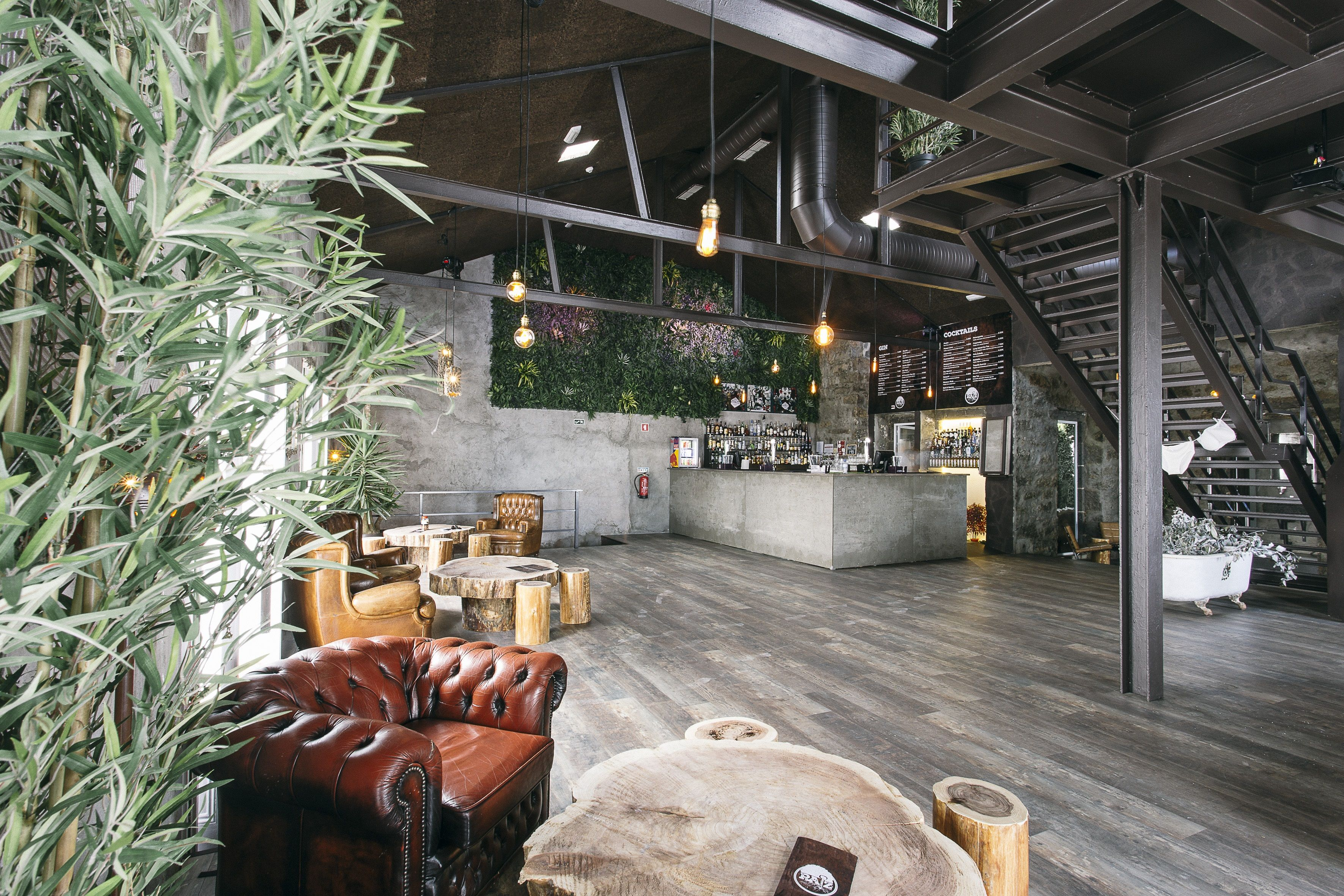 Livewall green wall system make conferences more comfortable - This Artificial Green Wall Foliage Creates The Perfect Botanical Backdrop For This Contemporary Bar Area