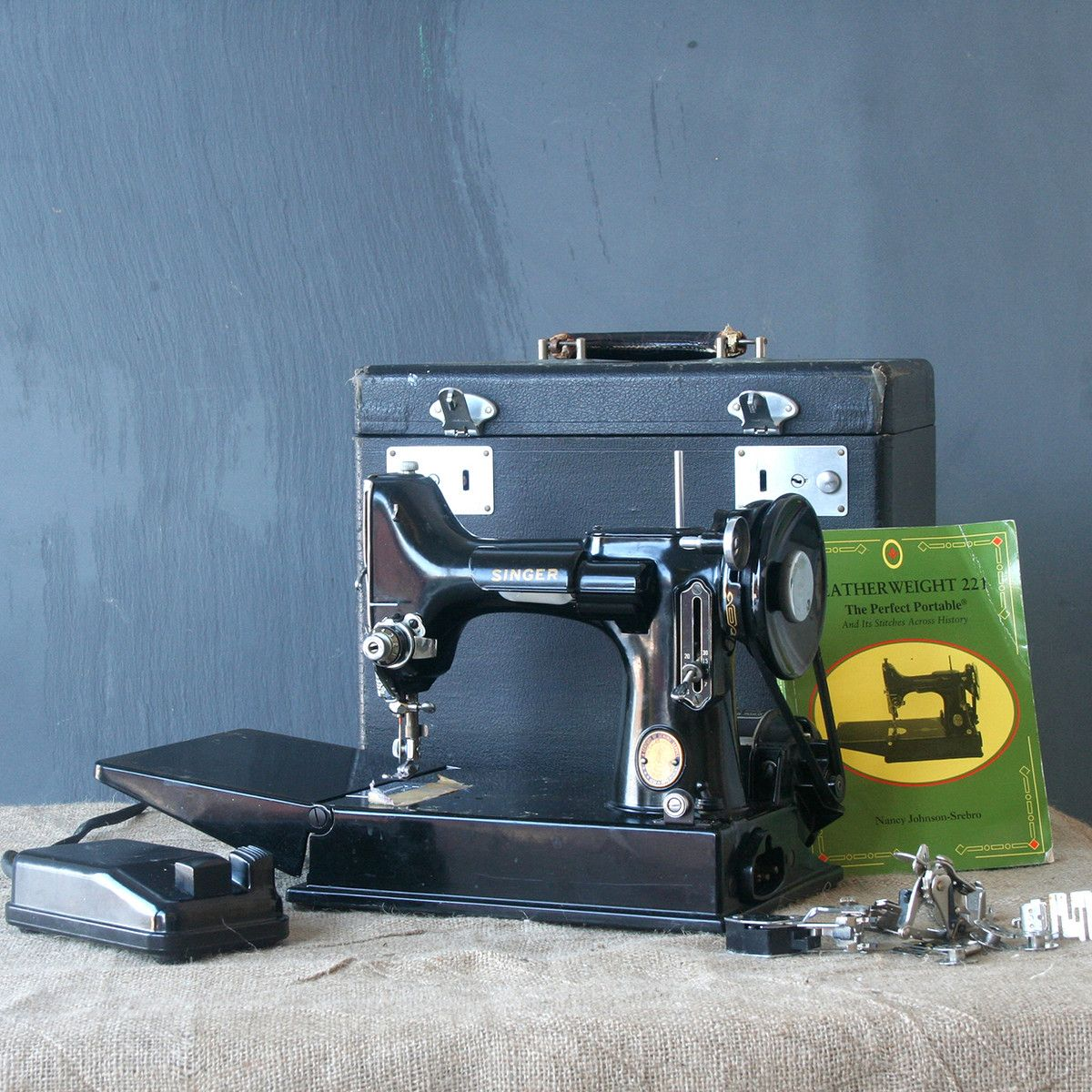Own a Singer Featherweight.....I HAVE 2 AND A FEATHERWEIGHT TABLE TOO!!!.....DONE