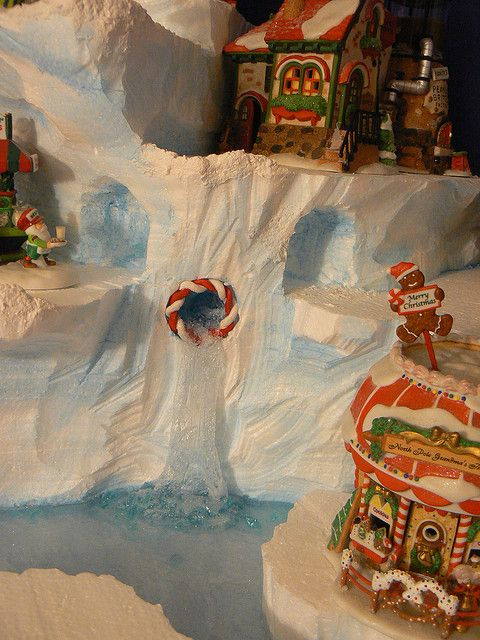 The 3 portholes for the frozen waterfalls in Cheri's display feature  candycane rims.