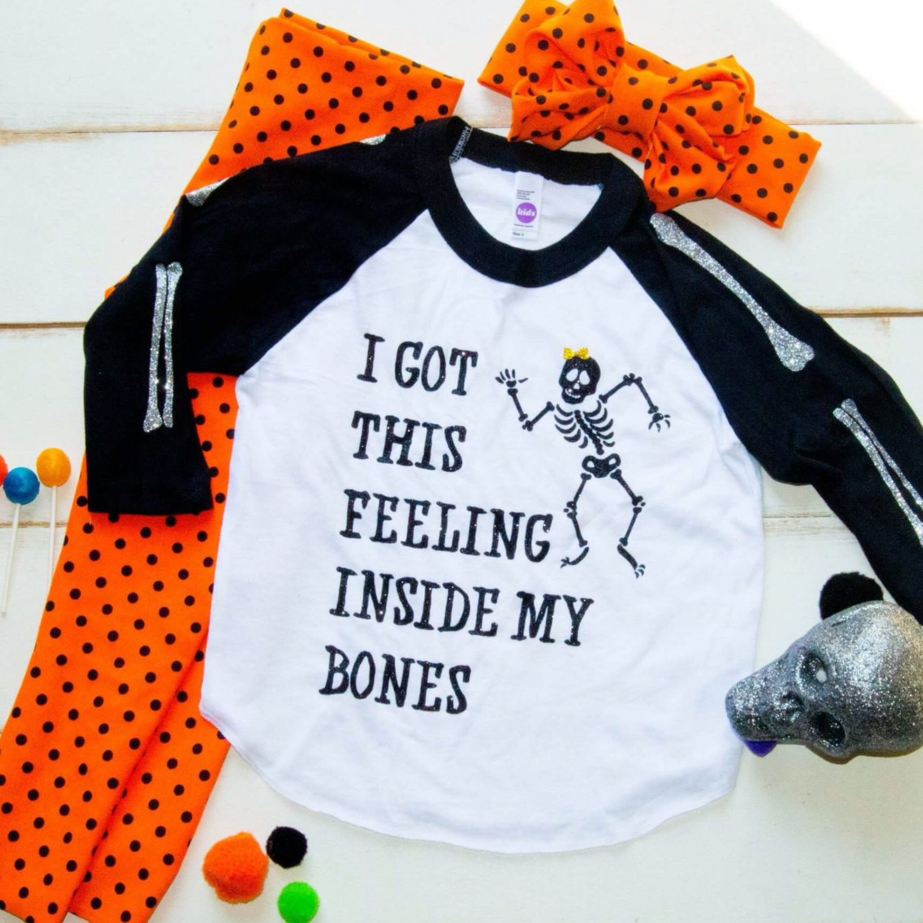 3f2c0b936bf Halloween raglan. Shop now on www.sparklebowtique.com even the sleeves have  sparkle bones too cute!!! Get Halloween