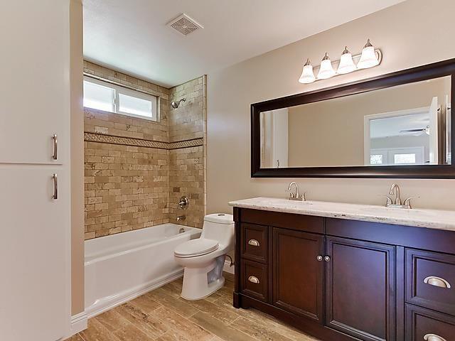 Carlsbad California Bathroom Remodel Distressed Wood Porcelain Tile Floors Dark Cabinet Vanity With White Granite Countertops Custom Shower Tub