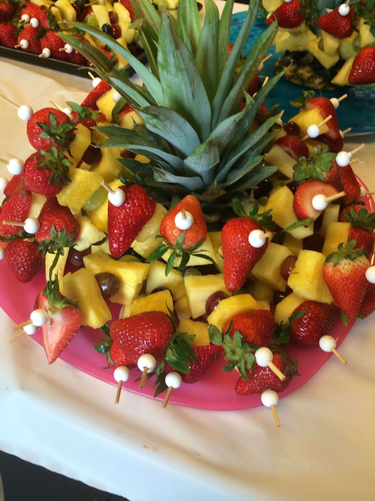 Mini Fruit Kabobs With Pineapple Top As Centerpiece Of Platter