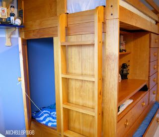 A Bunkbed With A Trundle Bed A Pull Out Desk A Book