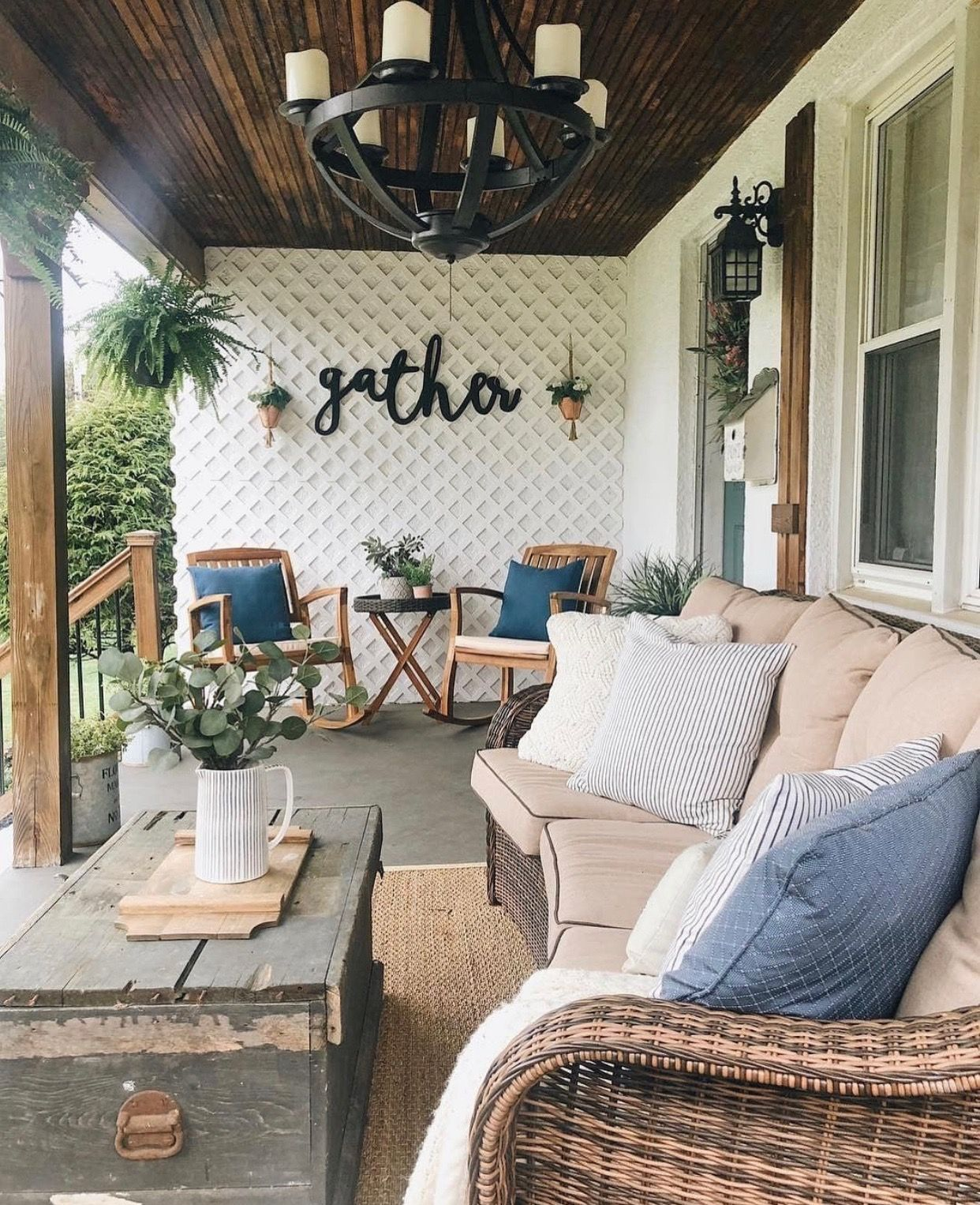 Country style porch decorated with wood furniture and