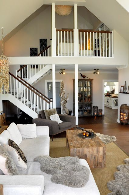 living room with loft overlooking it - neutrals and natural, Moderne deko