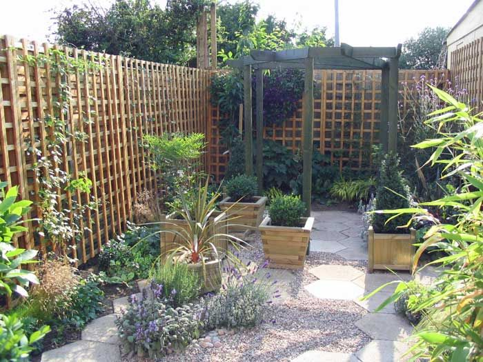 Painted Trellis Ideas Part - 41: A Trellis Painted In A Bright Color Might Disguise The Unsightly Fence.
