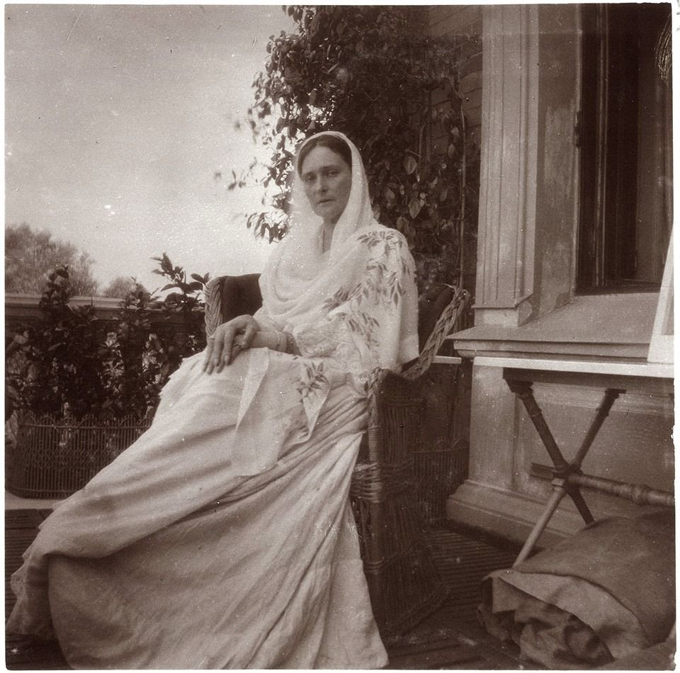 Alexandra Feodorovna in 1908. Seated on the balcony of the Lower Dacha situated in the Alexandria Park at Peterhof.