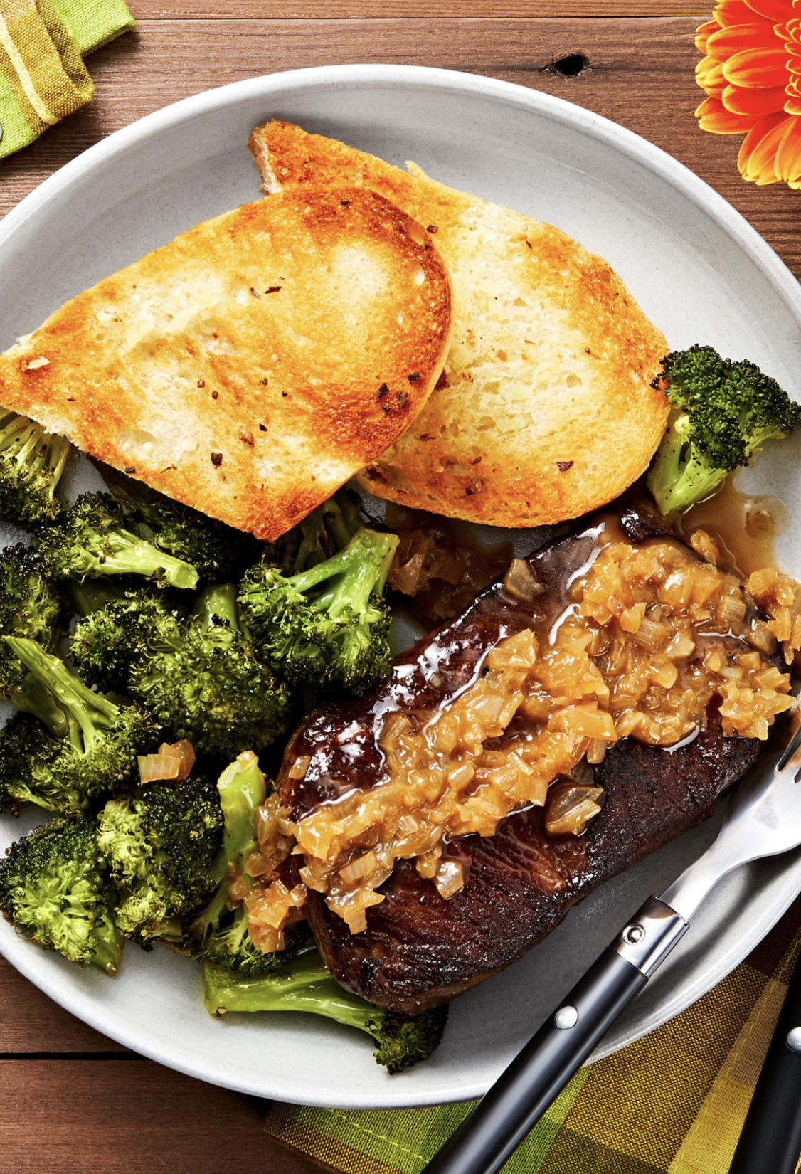 Sirloin And Shallot Pan Sauce With Garlic Bread And Spicy Roasted