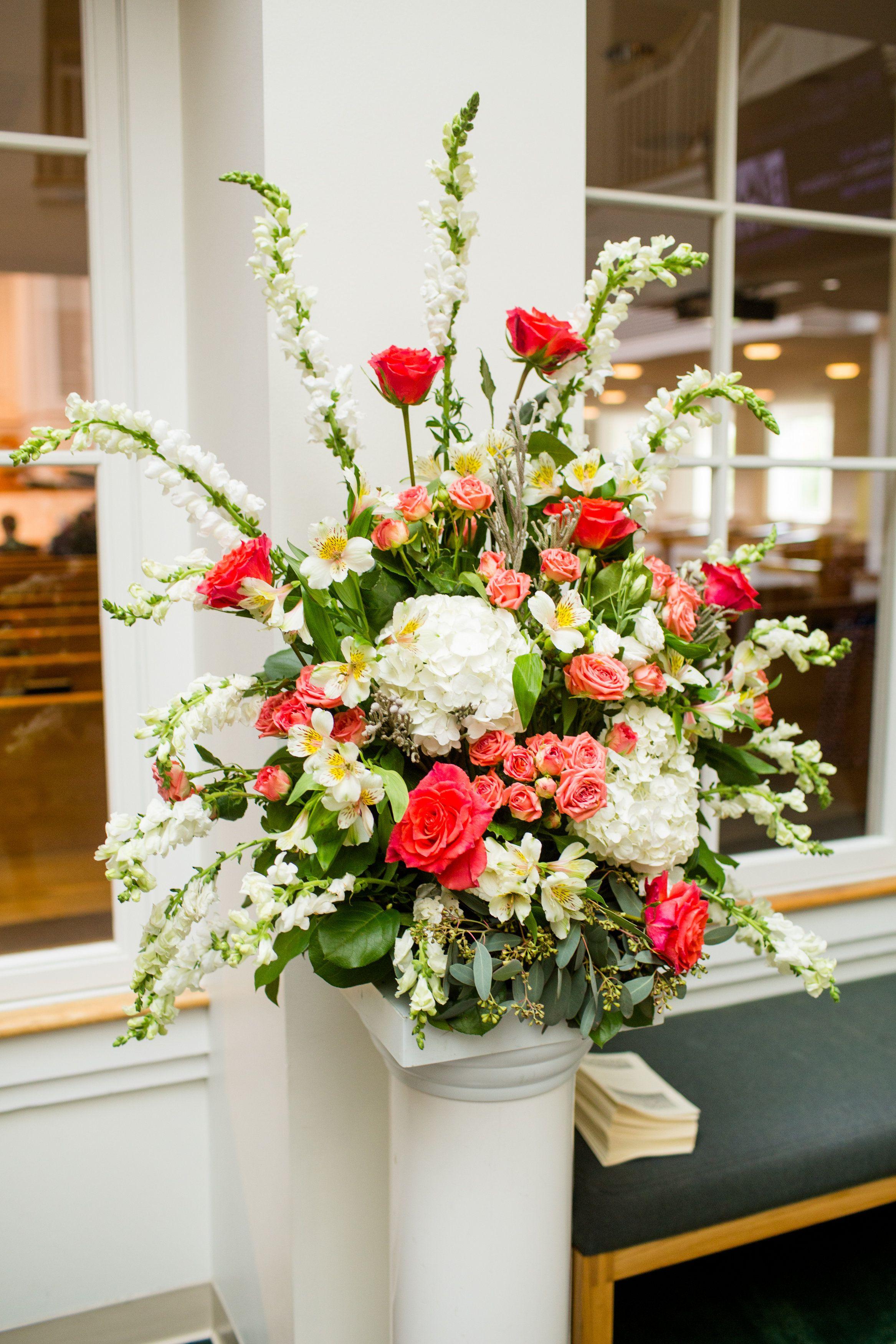Church alter arrangement of coral roses white hydrangeas