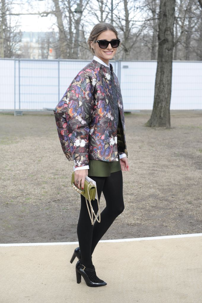 Olivia Palermo wears Valentino Jacket, shorts and shirt from the Pre-Fall 14/15 collection, a Valentino Garavani clutch from the Pre-Fall 14/15 collection and Valentino Rockstud Noir Sunglasses from the Fall Winter 13/14 collection to the Valentino Fall Winter 14/15 Fashion Show, March 4th, 2014, Paris.