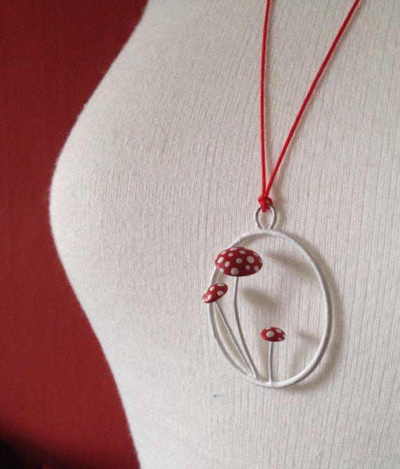 Toadstool pendant on red by bykateselene on Etsy, £38.00