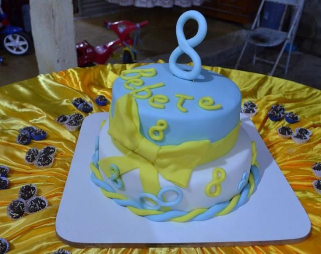 Tier Blue And White Round Birthday Cake With Yellow Bow For - Birthday cake 8 year old