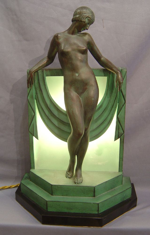 A fine bronze and marble Art Deco lamp by Fayral. With dark brown/green patination the sultry naked woman leans againset the typically Art Deco shaped plinth with a drape falling from her arms. Beautifully proportioned and entirely original, the lamp shows the sculpture off to perfection. Sogned in the bronze Circa 1930........Gavin Douglas Antiques