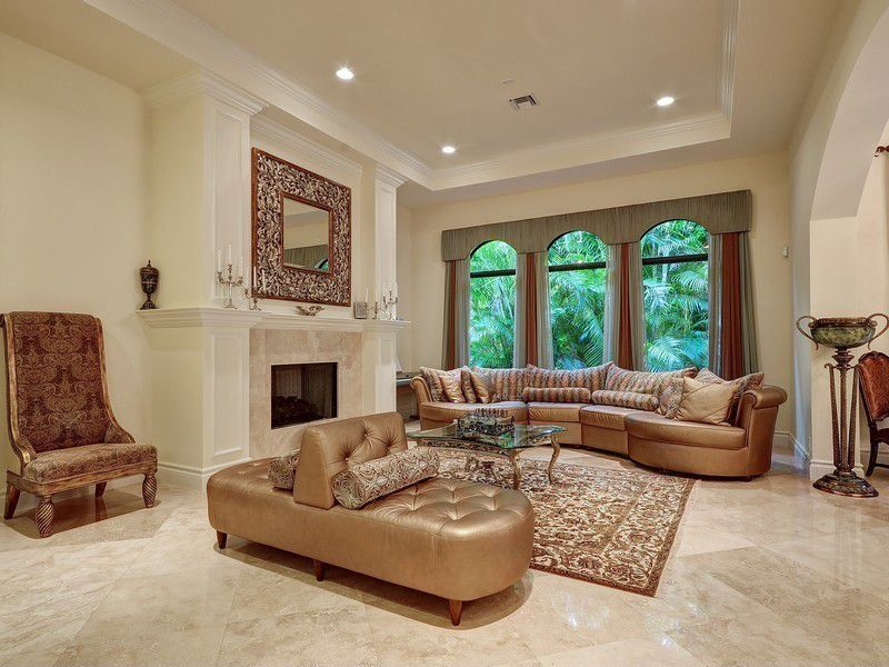 Traditional Living Room With Gold Sofas And A Beige Marble Floor Magnificent Living Room Marble Floor Decorating Inspiration