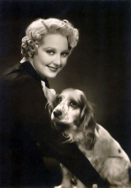 Thelma Todd and her Cocker Spaniël.