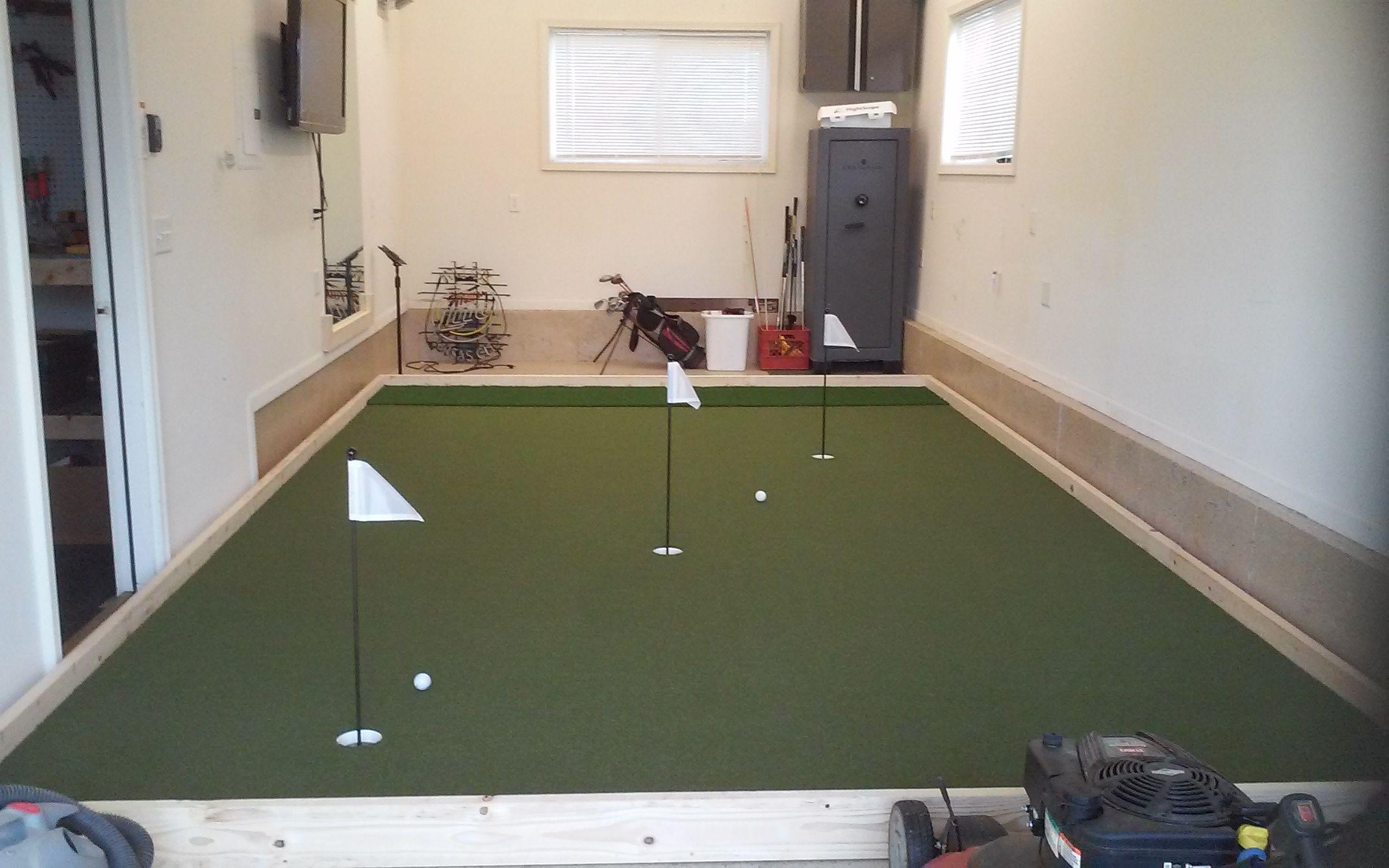 3rd car garage man cave synlawn golf putting green what a