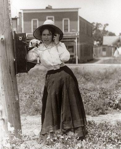 1900, Woman Talking On Hand Crank Oak Telephone History - stock job description