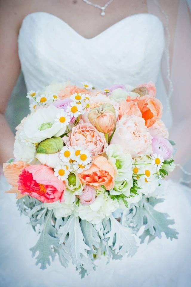 Bouquet of garden roses, anemones, fever few, poppies, ranunculus, dusty miller
