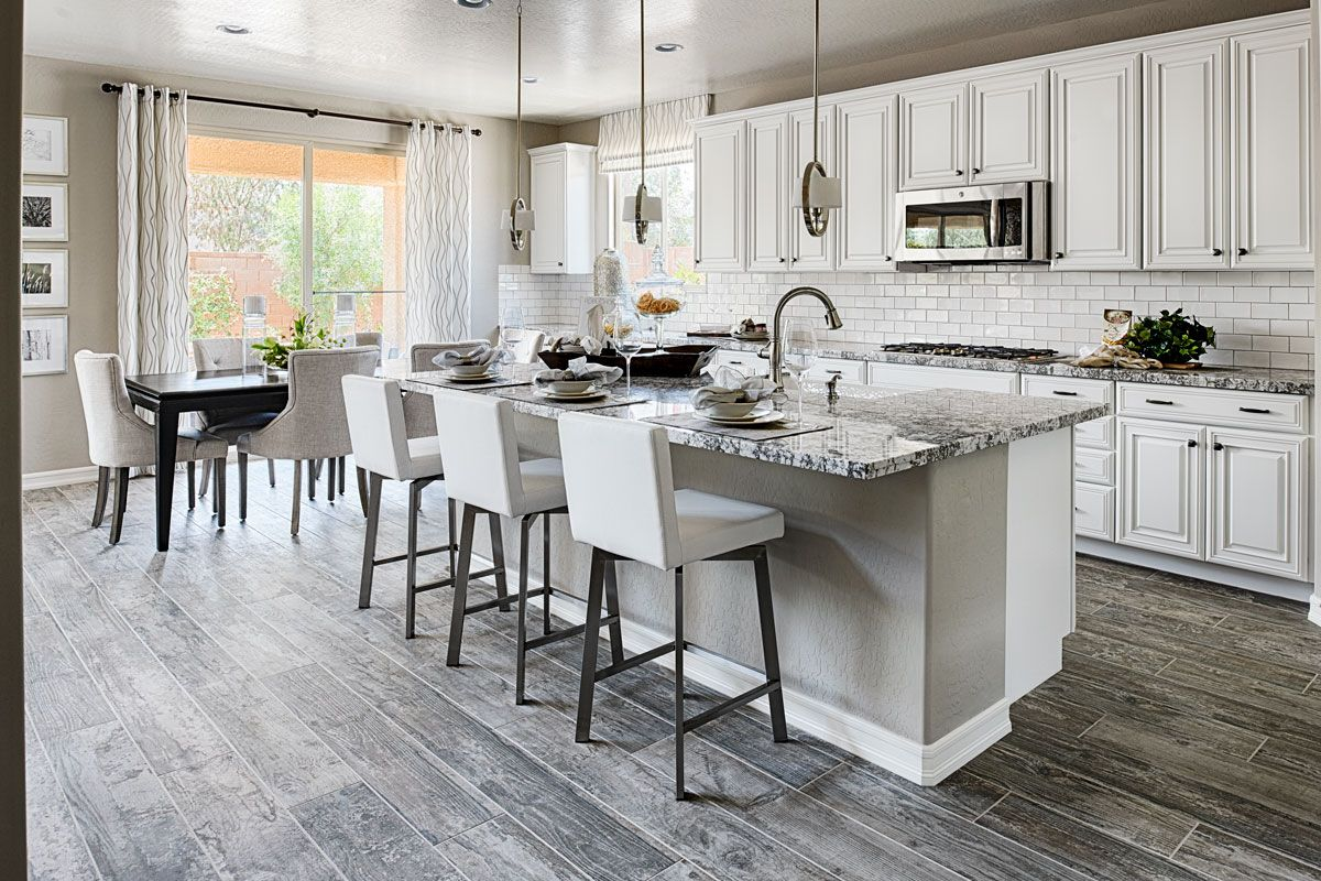 Elegant natural-stone countertops and white cabinets ...