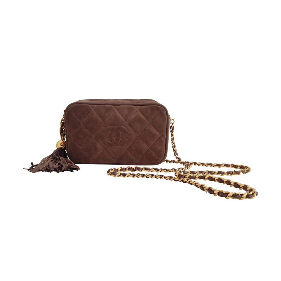Chanel Brown Suede Crossbody Purse with Tassel | From a collection of rare vintage shoulder bags at https://www.1stdibs.com/fashion/handbags-purses-bags/shoulder-bags/