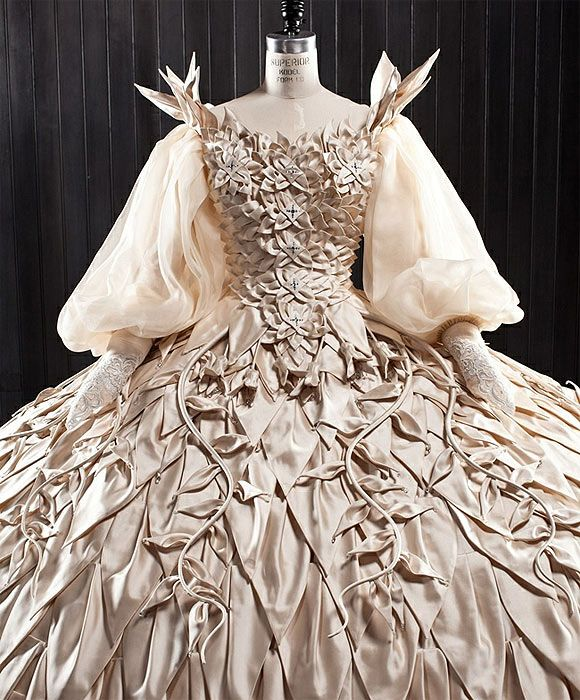 "This gown has such an organic quality.  It looks like each of the petals, vines, and leaves is an individual element.  I can only imagine how heavy this gown was to wear.  Eiko design for Julia Roberts in ""Mirror, Mirror."""