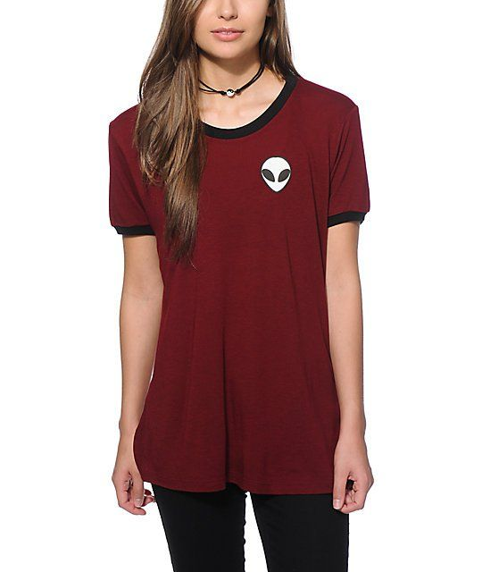 da50a67d Launch your style to another dimension with this burgundy colored ringer tee  that features contrast banded hems and an alien face graphic printed at the  ...