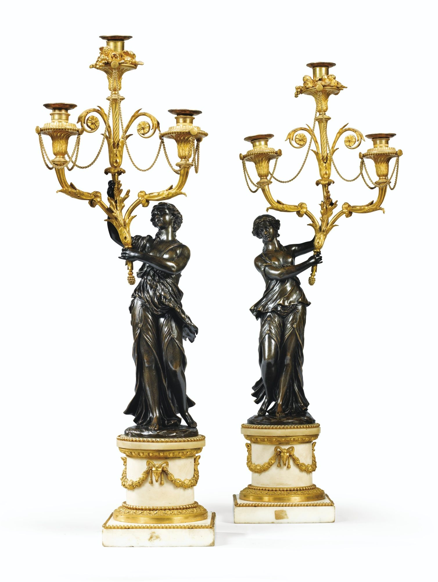 Date Unspecified A PAIR OF PATINATED AND GILT BRONZE CANDELABRA LOUIS XVI Estimate 7000 10000 EUR 7856