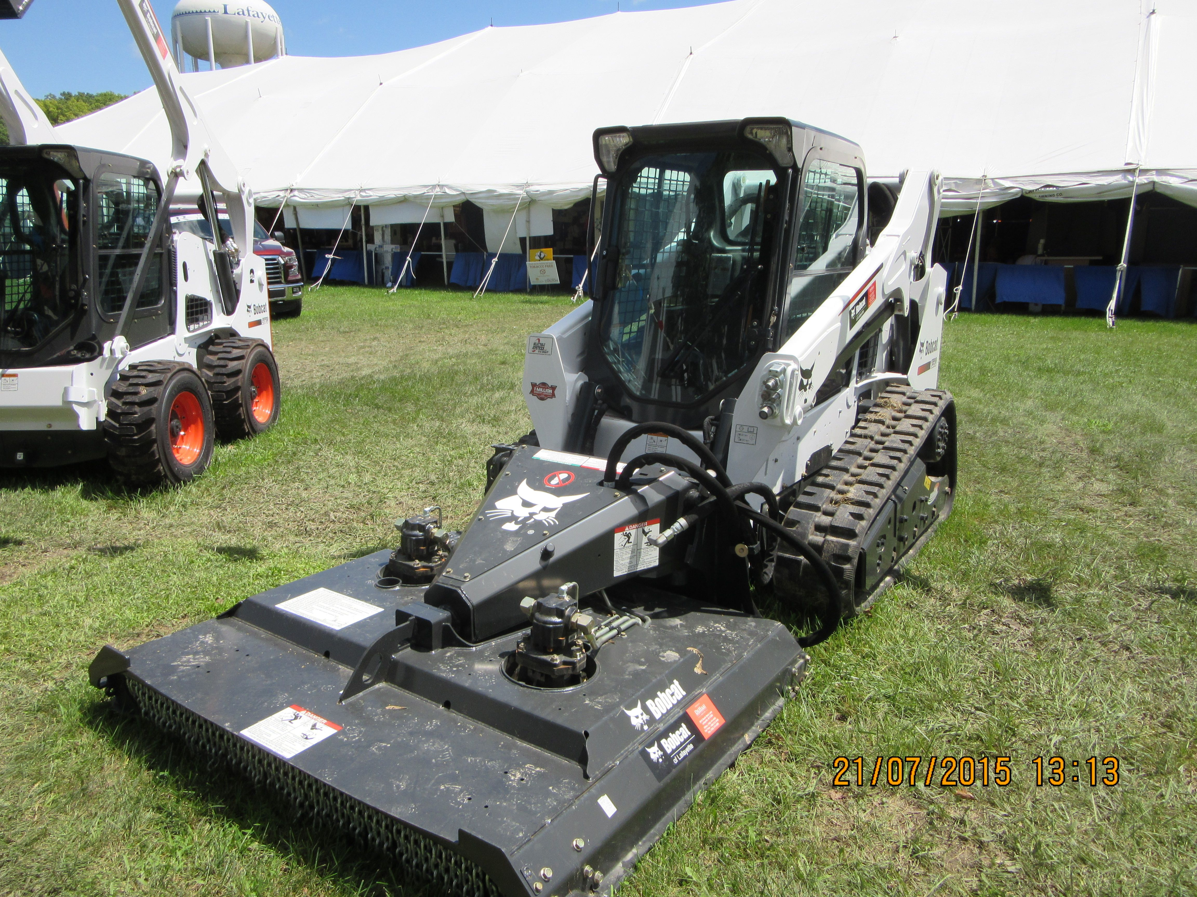 medium resolution of bobcat t590 with front mower attachment