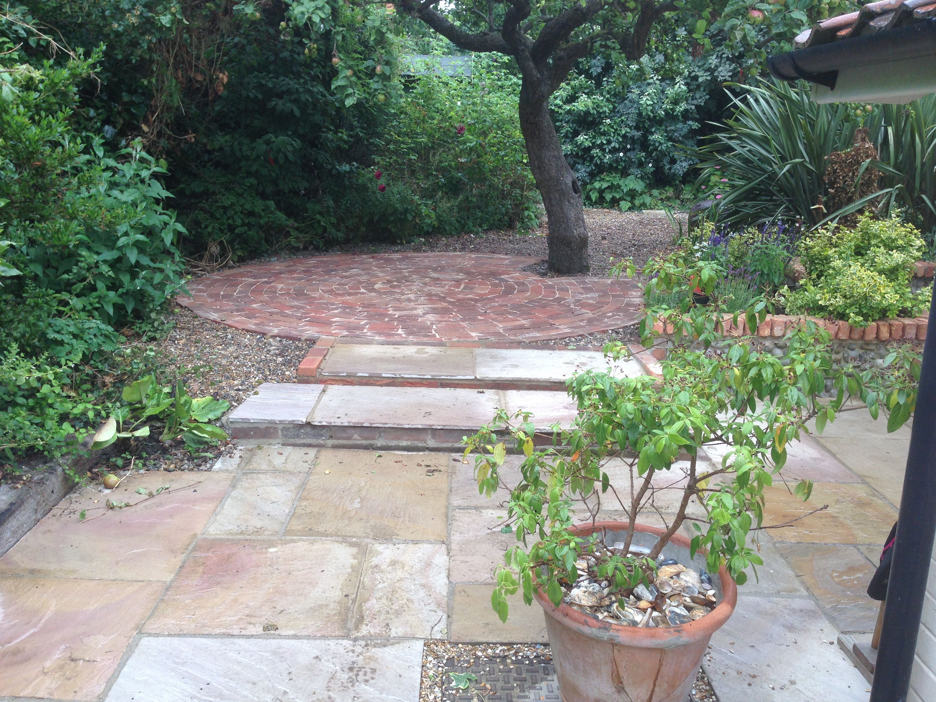 Sandstone Paving Steps And A Brick Patio Circle Under The
