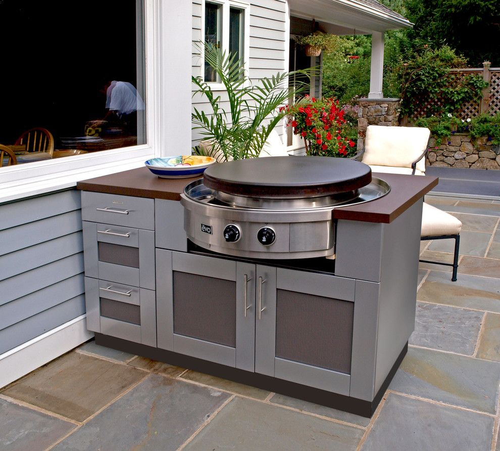 Outdoor Kitchen With Evo Circular Cooktop Designed By The Brown Jordan Outdoor Kitchen Collection Outdoor Kitchen Cabinets Outdoor Kitchen Countertops Build Outdoor Kitchen
