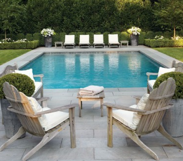 the raised round planters at opposite end flanking lounge chairs