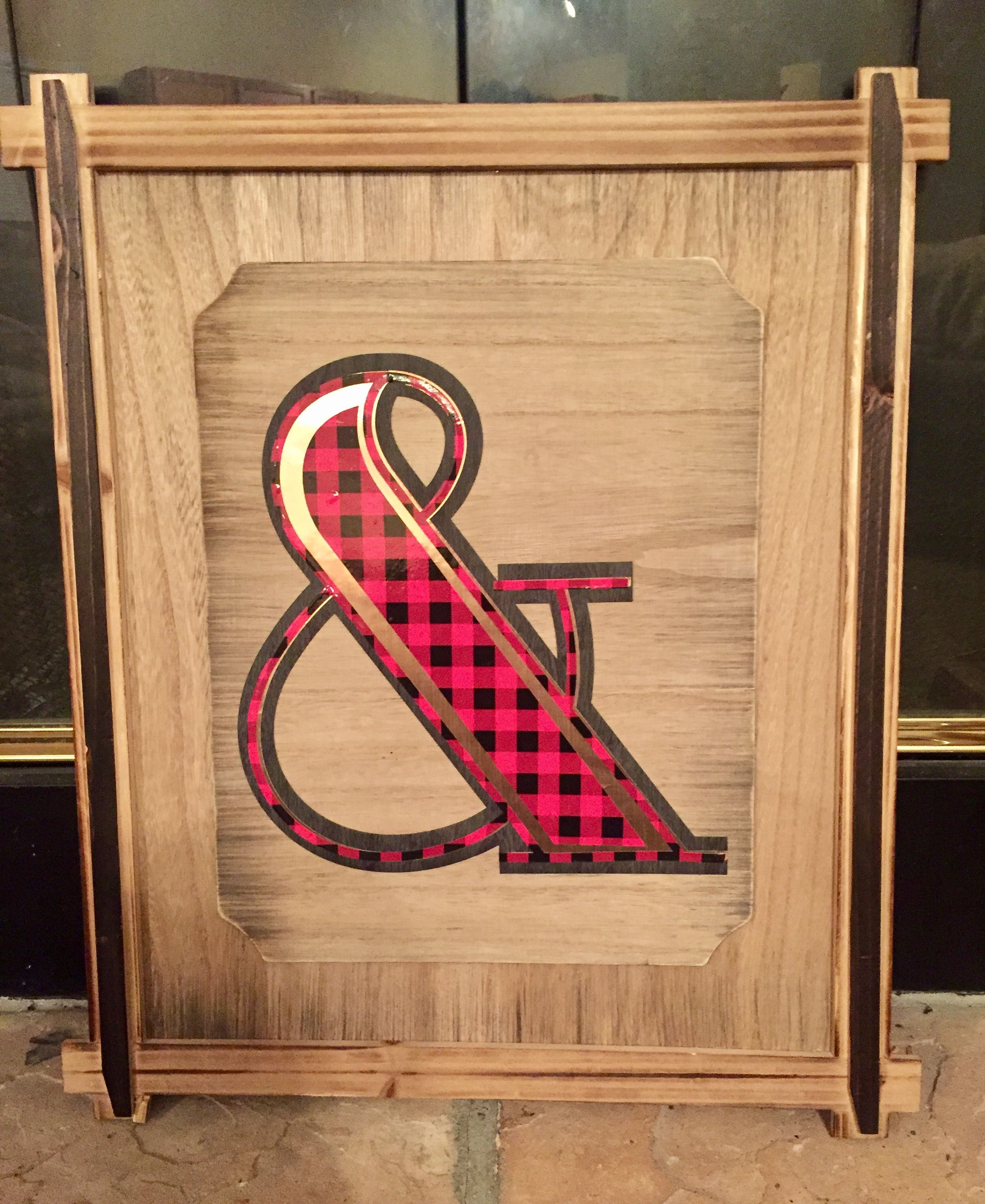 DIY ampersand wood sign with buffalo plaid and faux leather vinyl. Winter bedroom decor.
