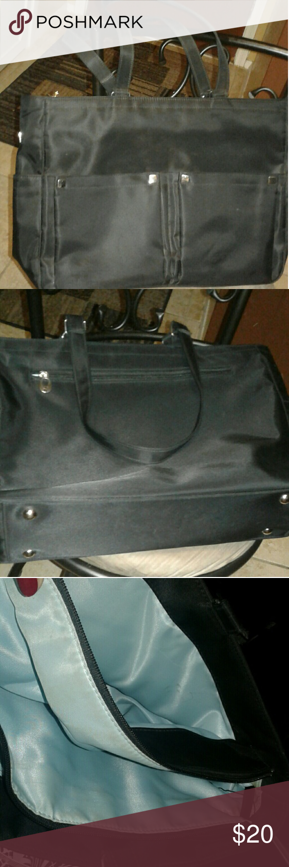 "Black Tote Black nylon bag with center zippered section. Front and side pockets. Back zipper. Footed. Appx 13x16x4.5 with 12"" drop. EUC.  Small stain. Can also be used as lap top bag but not well cushioned. Case Logic Bags Totes"