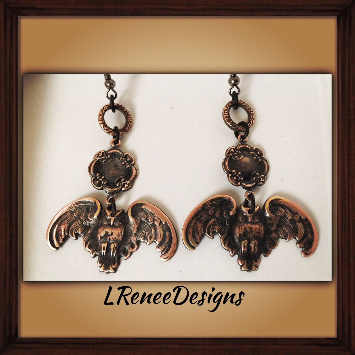 A personal favorite from my Etsy shop https://www.etsy.com/listing/472220708/owl-dangle-earrings